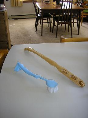 A Dish Brush with hook-like feet help me with opening drawers and cupboards and my Back Scratcher that doubles as a reaching device.